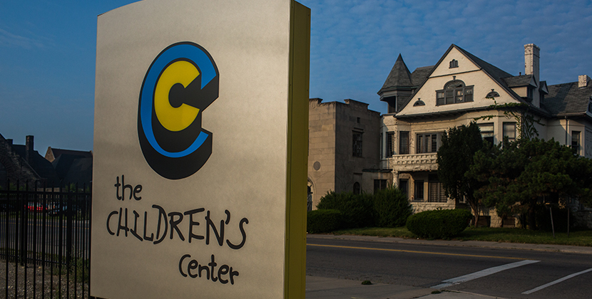 TCC Website Page-Photos-830x420-Logo-on-sign