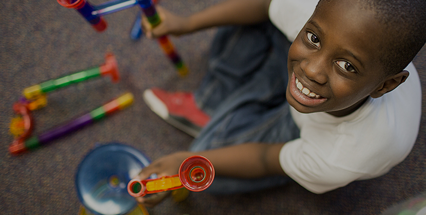 TCC Website Page-Photos-830x420-boy-playing